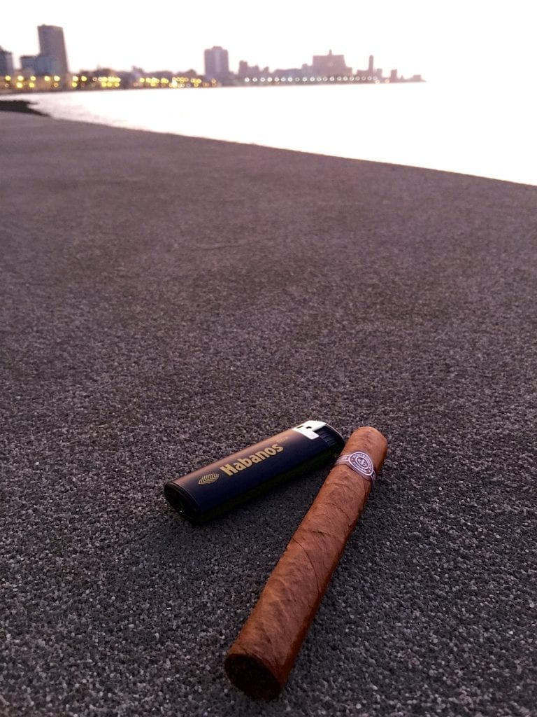 Enjoying a Romeo and Juliet cigar on the Malecon in Old Havana