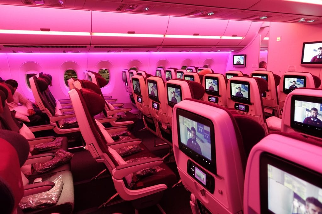book qatar airways with american miles