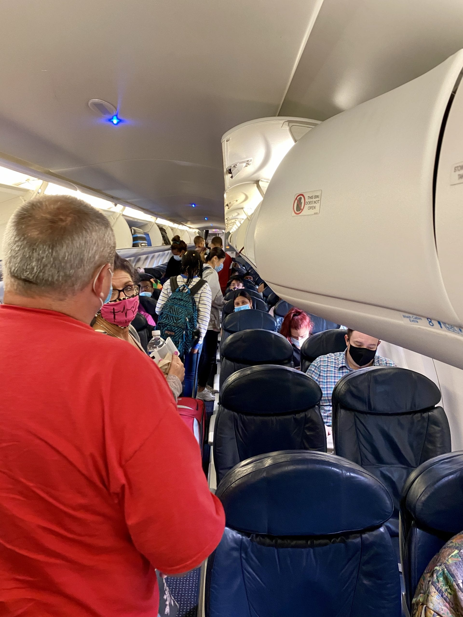 airlines block middle seats american